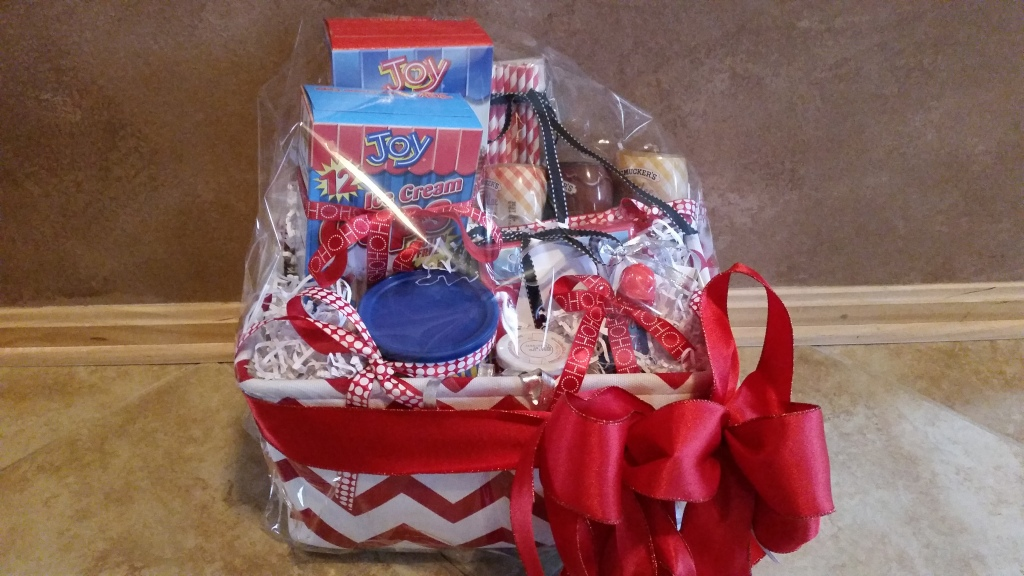 RAFFLE #83 Ice Cream Thank you to Family Fellowship Thursday Morning Small Group for donating this basket to us! • Ice Cream toppings, fixings, cones, straws, etc. • $30 Cold Stone Creamery Gift Card all in a beautiful red and white basket! Value $65 Raffle open to local participants only.