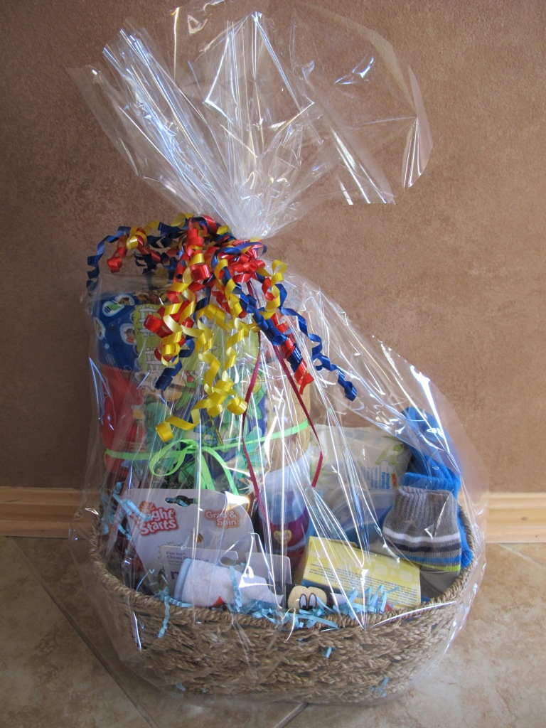 RAFFLE #40 Hand Made Baby Boy Quilt and Basket Thank you to Julia Swiger for donating this basket! • Baby Boy Quilt • 2 Toys • Pacifiers • Bibs • Bottle • Bowls with lids • Wipes • Hat & Gloves • Lotion, bath wash & shampoo Value: Priceless *Raffle open to everyone.
