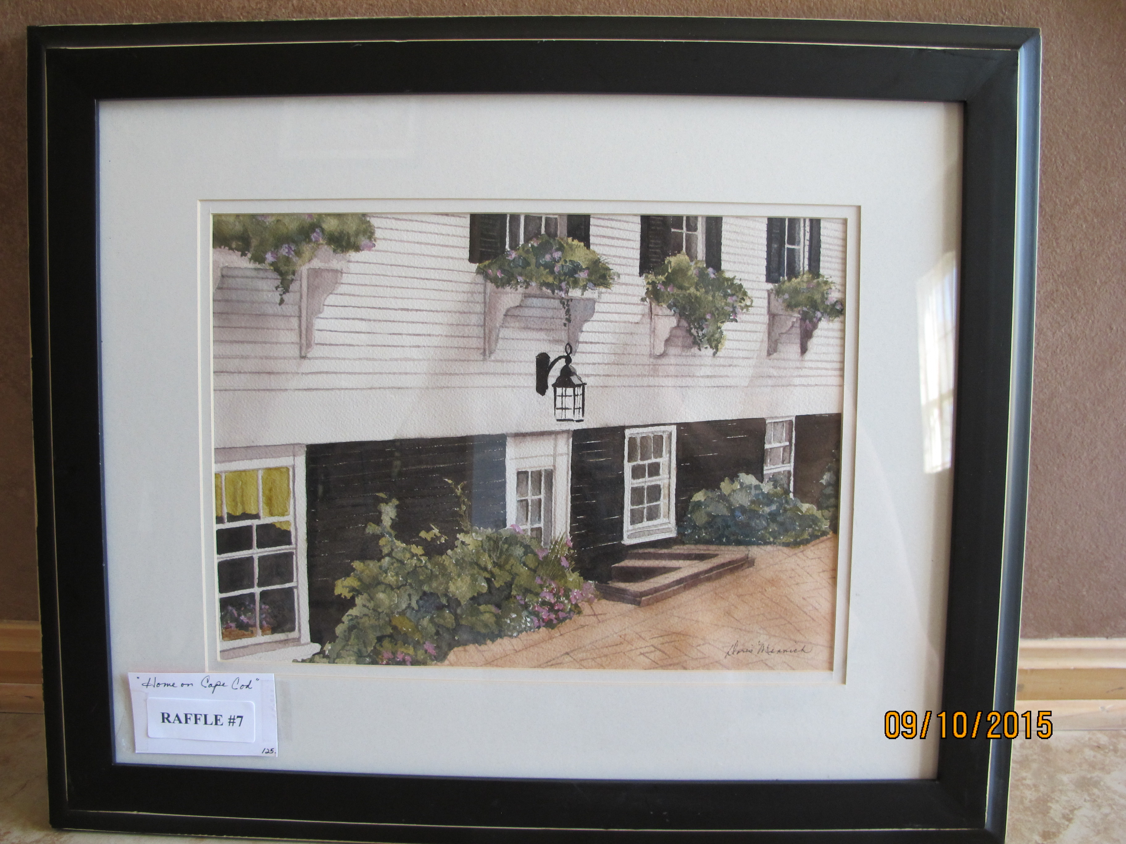 "RAFFLE #7 Framed Art ""Home on Cape Cod"" Thank you local artist, Doris Minnich, for donating this beautiful watercolor painting! A beautiful, framed watercolor painting, by local artist, Doris Minnich Value: $125 *Raffle open to local participants only due to prize size."