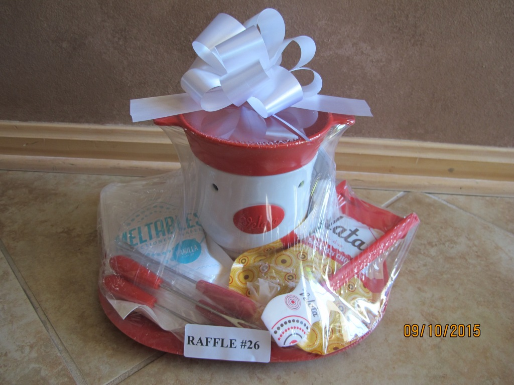 RAFFLE #26 Velata Chocolate & Fondue Warmer Thank you to Susan Enzor, Amherst, for donating this basket! •Fondue & Chocolate Warmer • Fondue Forks • Belgian Chocolate Fondue • Velata Spatula • Vanilla Meltables Value: $60.00 *Raffle open to everyone