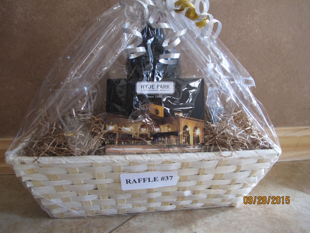 RAFFLE #37 HYDE PARK Thank you to Hyde Park for this basket! • $100 Gift Card to Hyde Park • Bottle of Wine • 2 Glasses Value: $130 *Raffle open to everyone with a Hyde Park near them.