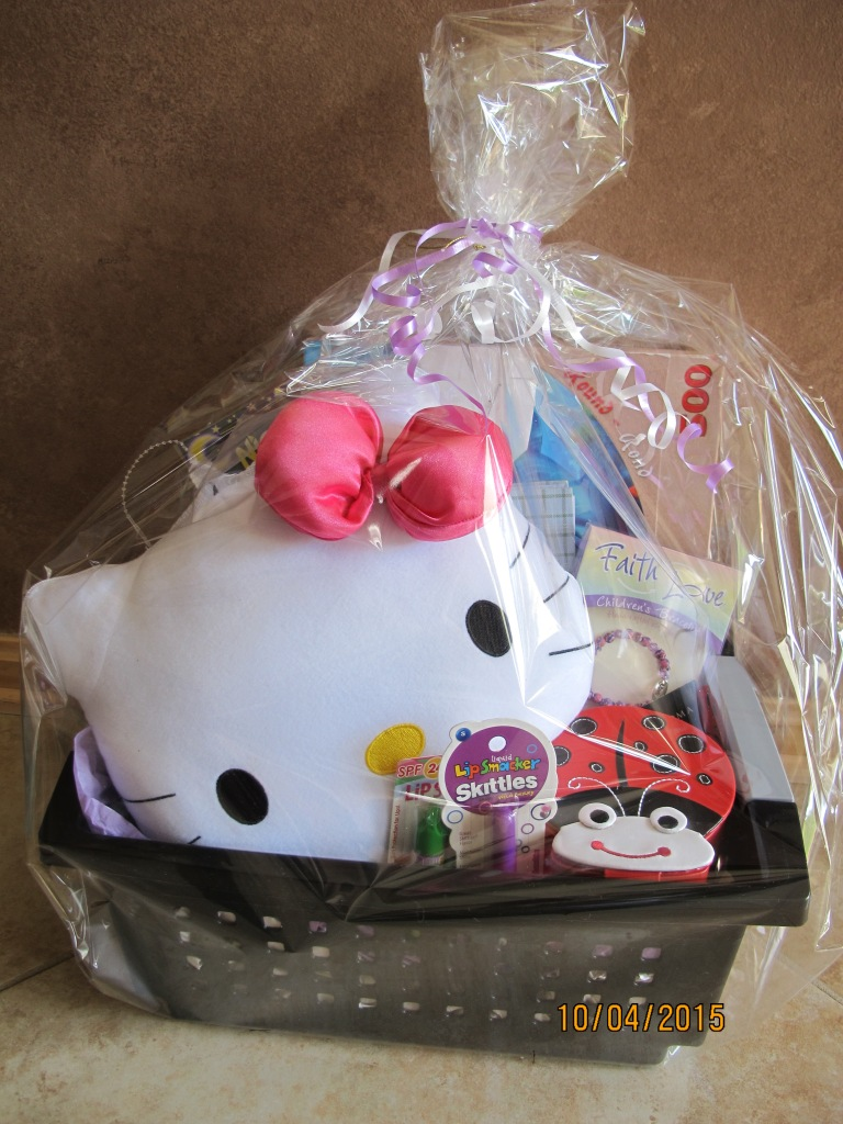 RAFFLE #52 Young Girl's Fun Basket • Hello Kitty Activity Set • Sea Life Puzzle • Stickers • Journal • 1500 Brain Quest • Two DIY DecorateTrinket Boxes • Faith Love Bracelet • Butterfly Necklace • Lady Bug Jewelry Box • Assorted Lip Gloss Value: $50 Raffle open to everyone.